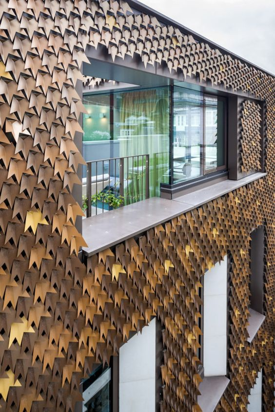 A private home in Mayfair, London gets a striking new exterior in the form of over 4,000 folded aluminum leaves in various shades of bronze. Architects: Squire and Partners: