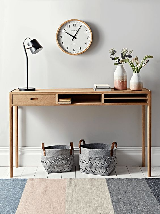 Crafted from oak, with a single smooth-slide drawer and two storage compartments, our long length console table is perfect for your hallway.  The sleek, simple design and subtle wood grain make for an elegant storage solution.