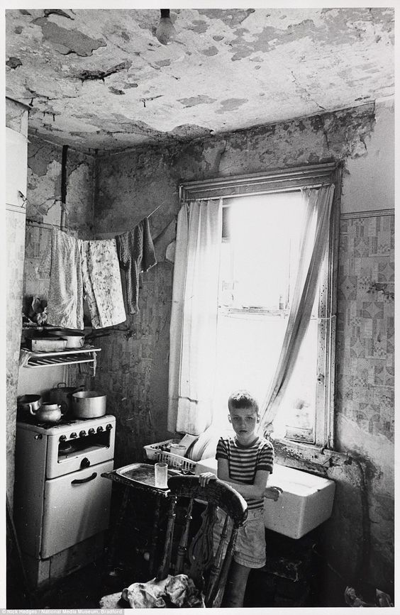 With mould and cracked plaster adorning the walls, and a makeshift washing line sweeping a...