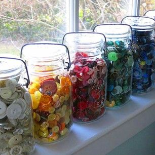 Sorting a button collection by color is aesthetically pleasing (as well as a time saver). | 31 Incredibly Creative Ways To Display Your Collections
