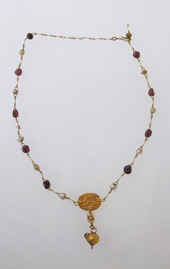 Necklace with pendant and glass beads Date: 1st century B.C.–2nd century A.D. Culture: Roman Medium: Gold, glass paste Dimensions: Diameter: 5/8 × 1 1/16 in. (1.6 × 2.7 cm):