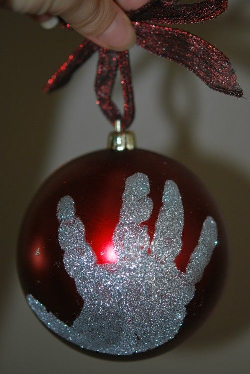 Print a childs glttery hand or foot print on an ornament Make