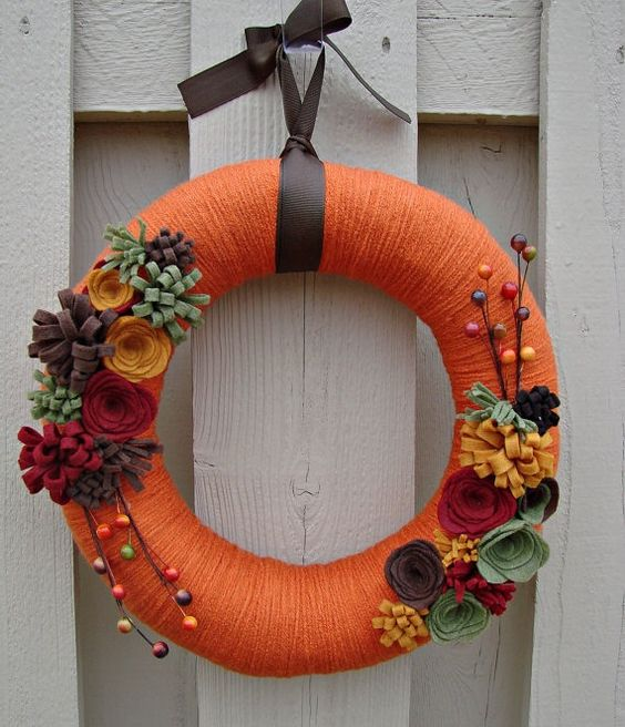 Burnt orange yarn wrapped wreath sage green, maroon, brown and gold