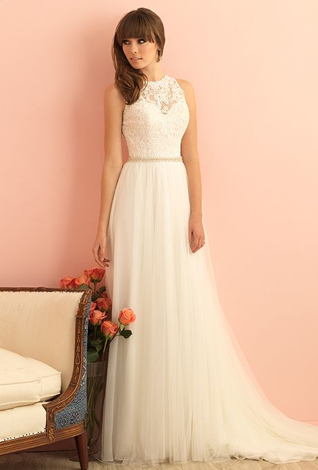 Brides: Allure Romance. Gossamer layered tulle pairs with delicate lace in this sleeveless gown.