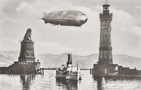 Zeppelin Airship flying over Lindau Germany, 1930s  Interesting composition, but seems as though the photographer was trying to capture too much in one photo,but still...I like it.