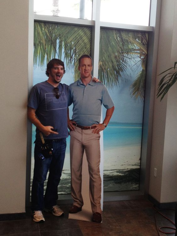 We printed and installed the graphics on the windows behind Peyton Manning!