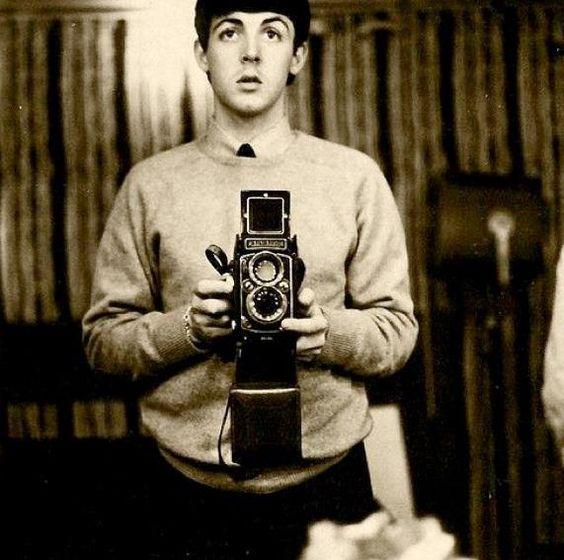 Paul McCartney self with a twin reflex camera