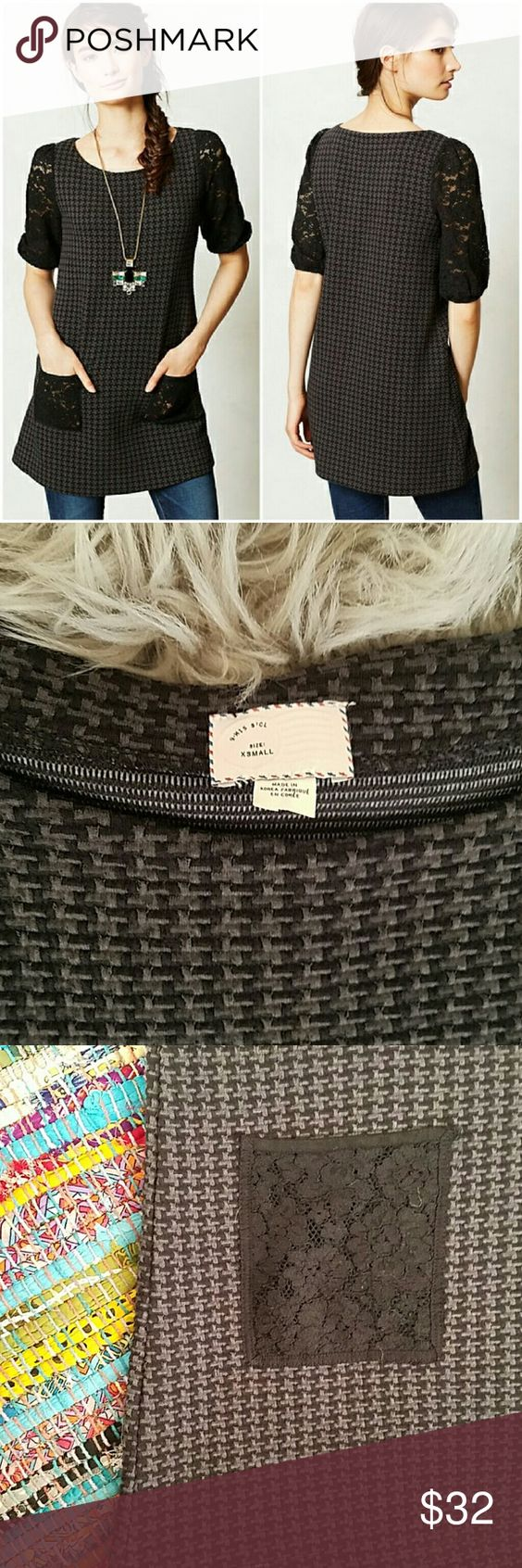Anthropologie Lace Sleeve Houndstooth Tunic XS This is a like new tunic from Anthropologie. Gray and black. Stretchy cotton blend. Textured gray and black houndstooth body. Like new condition with no flaws. Xsmall, but an oversized fit. Anthropologie Tops