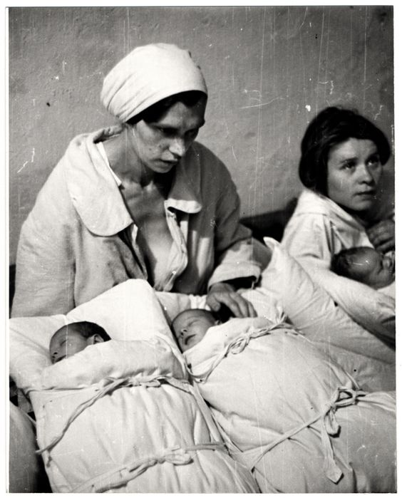 Siege of Warsaw by German forces in September of 1939: Two Polish mothers pose with their newborn infants during the siege of Warsaw.