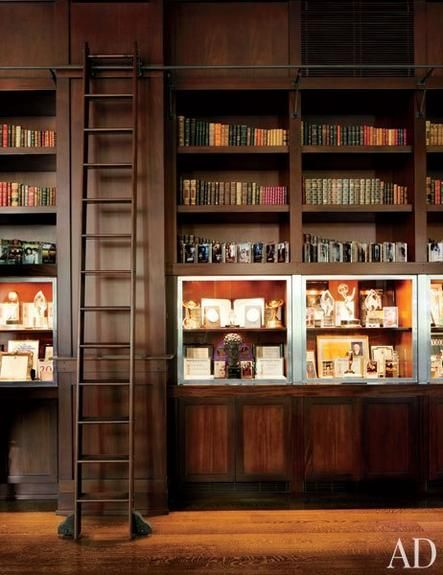Awards fill vitrines in Hollywood executive Peter Grubers's home library.