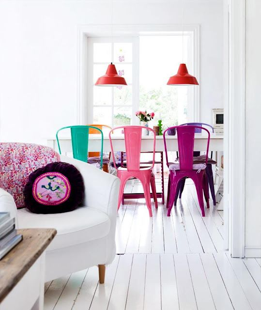 I love the multicolored Tolix Marais A Chairs in the dining room.