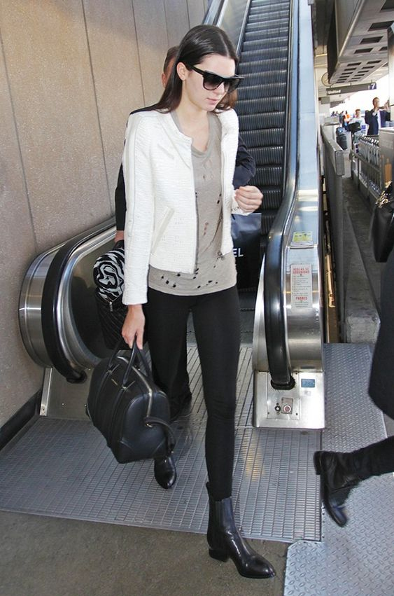 Kendall Jenner's ladylike white jacket and top-handle bag lend a touch of elegance to her distressed t-shirt. // #Celebrity