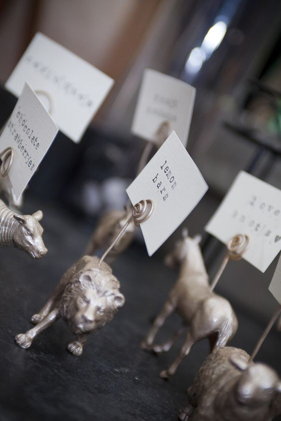 """Labels for food at the reception. These can be made by buying those plastic animal figurines you can get at any toy store and adding a """"clip"""" using gardening wire, then spray painting the whole thing in the color palette of your celebration."""