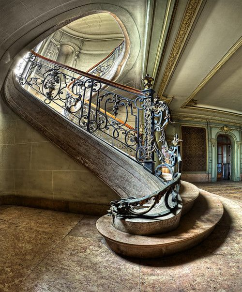 The circular opening at the top of the stairs is lovely.