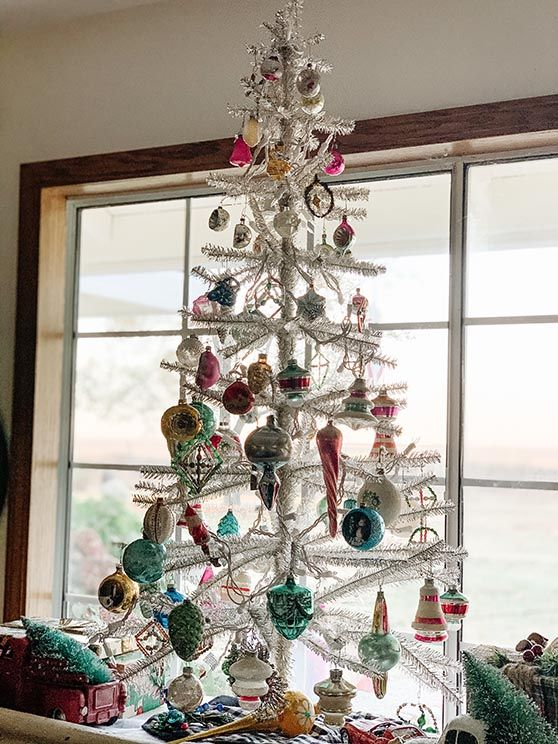 20 Best Silver Christmas Trees In Every Style And Price Range Candie Anderson Silver Christmas Tree Vintage Silver Christmas Tree Christmas Tree Themes