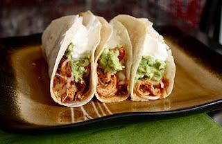 Crockpot chicken taco recipe via the MyChocolateTherapy blog.  These look delicious and easy!
