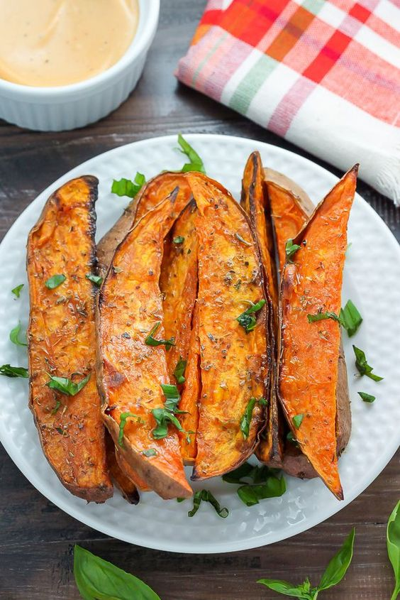 Extra Crispy Sweet Potato Wedges -- cooked on a rack over a baking sheet for 35 min, then broiled for the last 3-5 min.