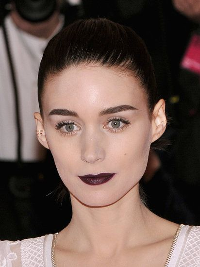 Rooney Mara's lacy gown was superfeminine, but she toughened up the look with an aubergine lip color and an inky hair color. #MetGala