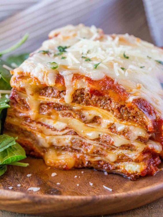 Ultimate Meat Lasagna with four cheeses, a homemade marinara sauce and a few quick cheftricks will make you feel like you've ordered lasagna at your favorite Italian Restaurant.