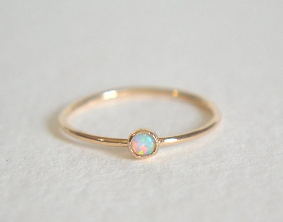 One gold filled ring. Super cute and tiny 3mm white opal gemstone, set in solid 14k gold cup. The band is gold filled and thin at 1mm. Polished for a