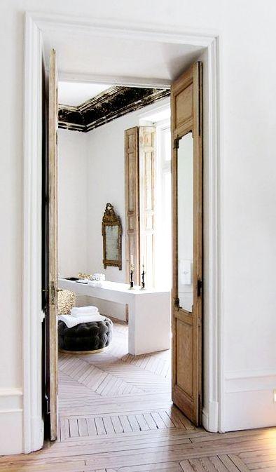 = chevron floors and mirror door detail