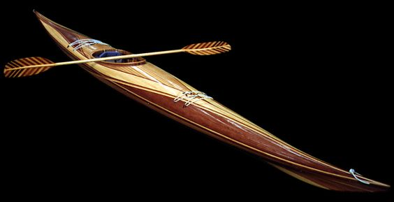 Graphic Stripping: On this Expedition Single I took graphic stripping to an extreme using redwood, western red cedar and pine. It also includes inlaid graphics on the hatches. Nick Schade, handmade kayaks and canoes