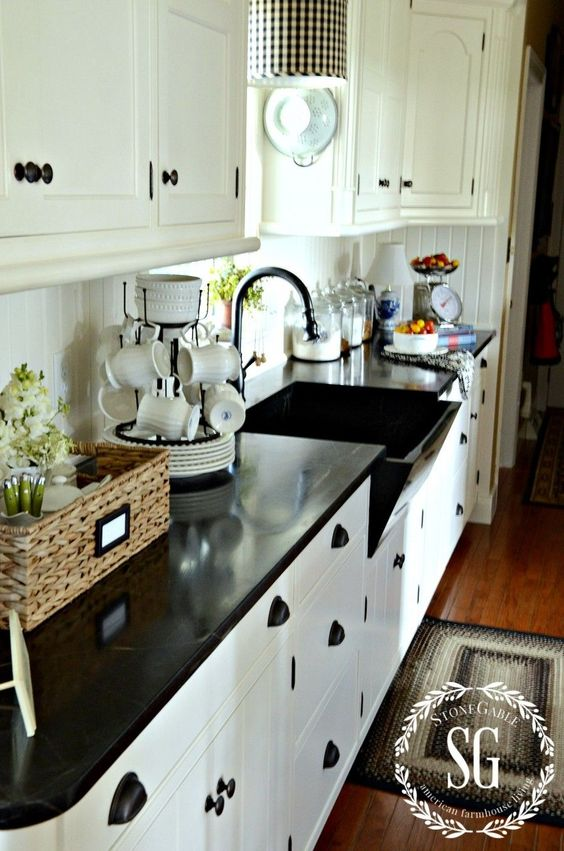 #FARMHOUSE_STYLE Painted kitchen cabinets, especially white ones, are a farmhouse favorite! Beadboard pairs fabulously with white cabinets!