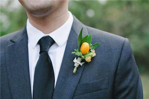 Great alternative to flower for the groom - use a cumquat with some exotic foliage and accents