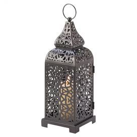"""Iron candle lantern with openwork filigree panels.   Product: LanternConstruction Material: Iron Color: BlackAccommodates: (1) Pillar candle - not includedDimensions: 13"""" H x 4.3"""" W x 4.3"""" D"""