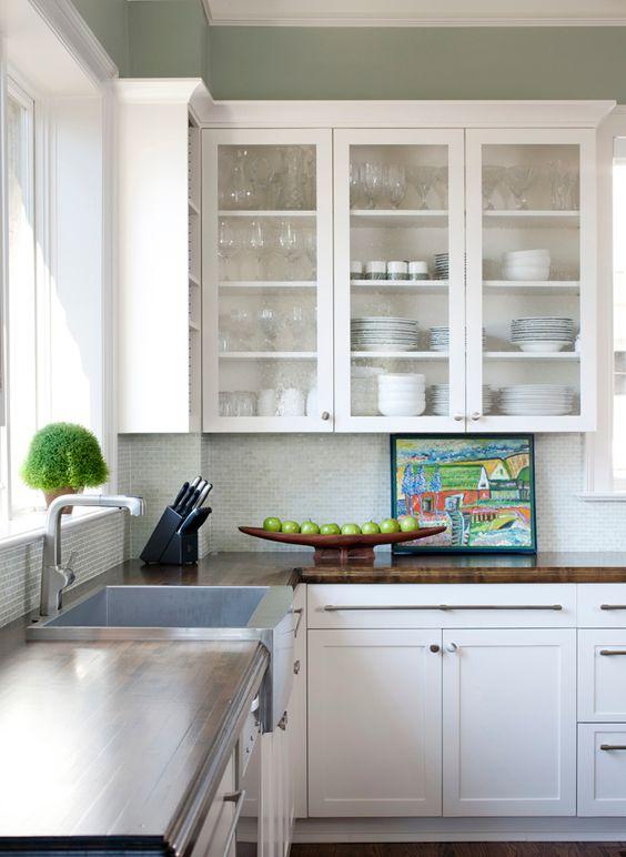 Modern farmhouse kitchen. Glass front cabinets + walnut counter ...