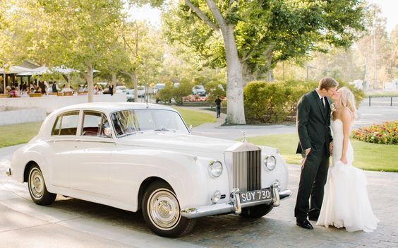 A classic car is a great alternative to a limo for the wedding day! #vintagecar #carrental #weddingday #weddingdaytransportation #vintage #classiccarrental #classiccar