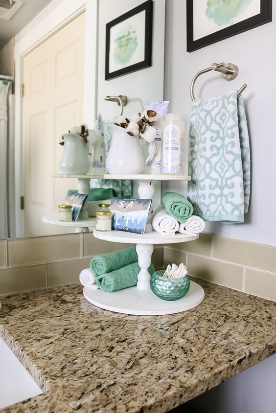 Look at this super cute DIY round farmhouse tiered tray decor for the bathroom! Would also look really cute in the kitchen. Bring out your inner Joanna Gaines!
