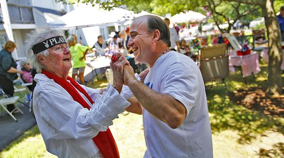 Millie Naun, who loves to dance to Elvis, gets a few moves in with neighbor Steve Higgins at Thaxter Park. Naun turned 100 in Hingham on Sunday, June 26, 2016. — Greg Derr/ The Patriot Ledger.