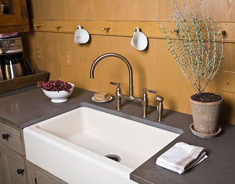 Porcelain Sink in a poured concrete counter top.