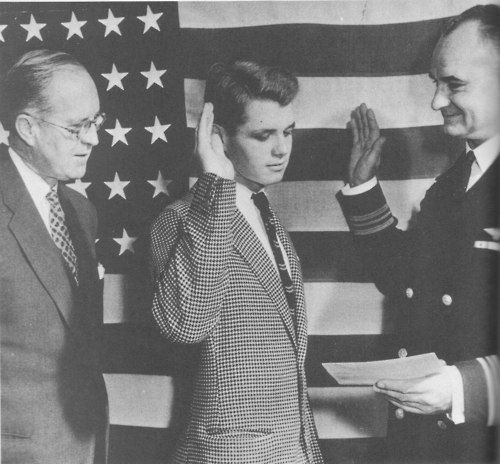 Bobby being sworn in to the navy at age seventeen in 1943 while his father watches.