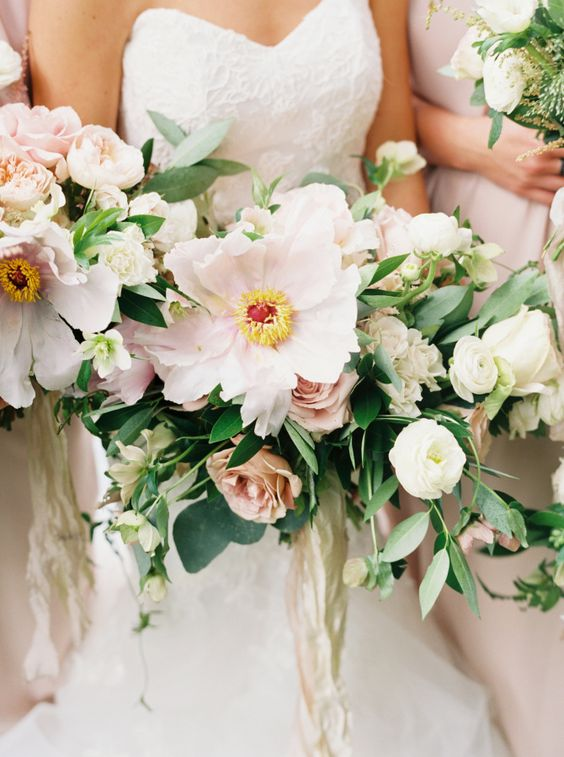 Pretty blush and cream bouquets: http://www.stylemepretty.com/2016/04/20/a-whirlwind-hometown-wedding-filled-with-heart/ | Photography: Annie Parish - http://annieparishphotography.com/