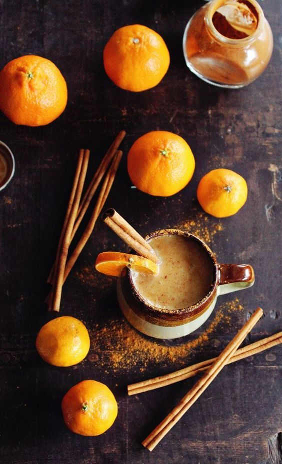 Almond milk chai with whiskey and orange. A warm and cozy vegan chai cocktail with whiskey and fresh orange juice.