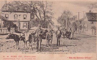 Vintage postcard of Jacksonville Florida showing black workers and ox drawn cart.