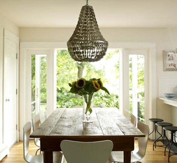 Rustic Wood Table And Metal Chandelier In Open Kitchen With French Doors To Patio