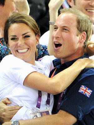 Kate Middleton and Prince William celebrate the British sprint team's world record at the velodrome on Day 6.
