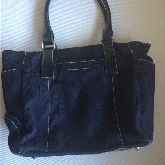 """Calvin Klein - logo fabric Tote - black The ultimate in modern chic, Calvin Klein softly structured leather tote Black color. Fabric - ck logo print  Imported Zip closure 2 handles  Interior features 1 zip pocket 14"""" H  Two side pockets One front pocket  Zipper bottom area for umbrella Calvin Klein Bags Totes"""