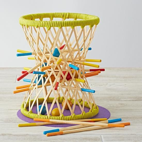Choose a color, then try to keep your balls in the basket as you remove your sticks one by one. Last color remaining in the basket wins.