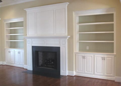 built in book cases and cabinets around a gas fireplace and tv ...