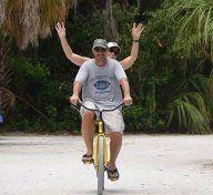 Couple Tandem Biking