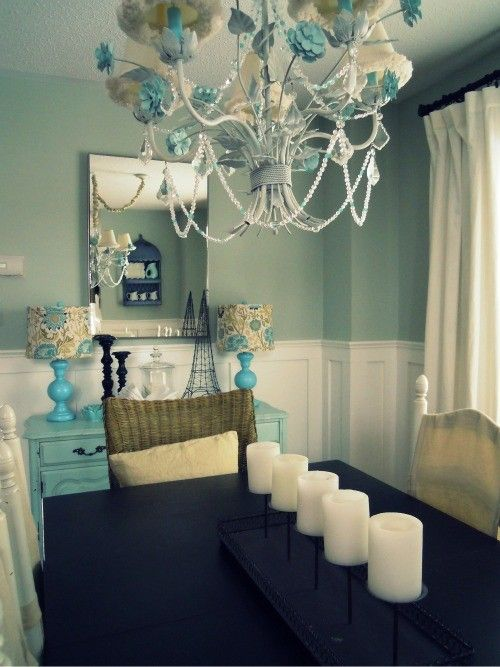 love these colors together. i really like the teal hutch and lamps behind the table!