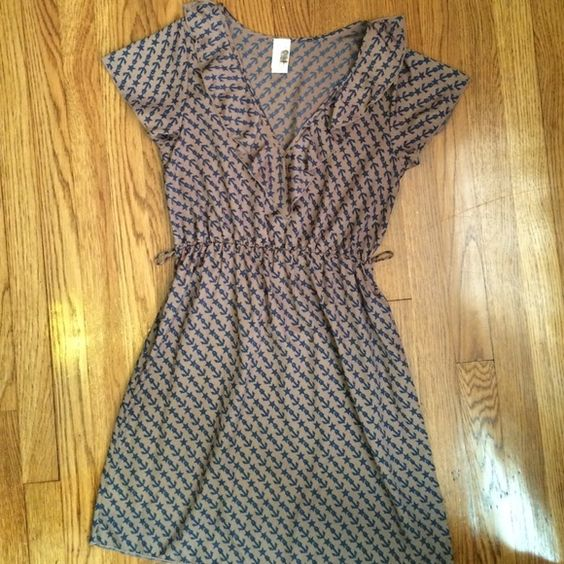 medium brown and navy sailor print dress great shape but missing the belt, this adorable lightweight sailor print dress is perfect for summer nights out. 100% polyester. the background is a medium brown with a slight gold sheen and the anchor/star print is navy. Dresses Mini