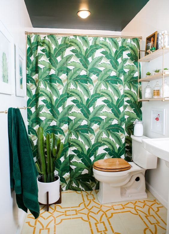 The bathroom's tile floor was actually painted by Brigham using a stencil. The Tommy Bahama shower curtain gives a nod to the guest room and dining area.