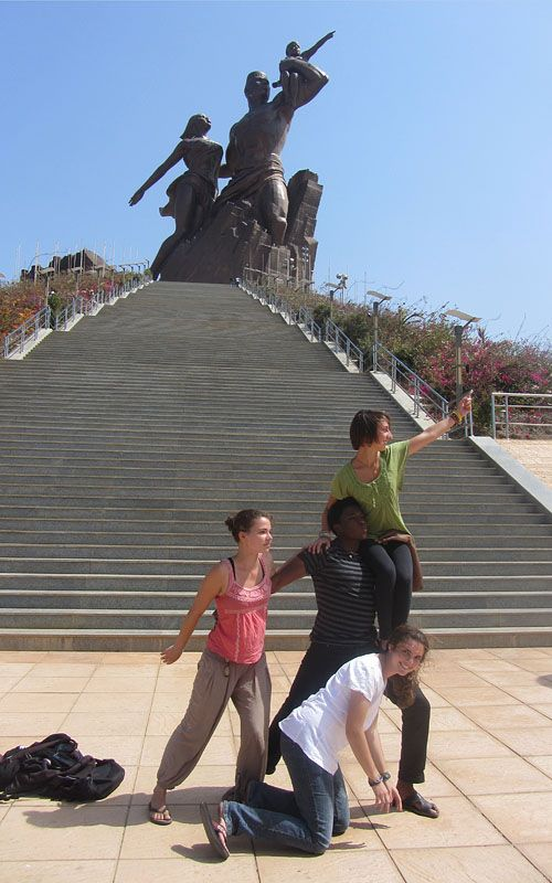 Students studying abroad in Senegal reenact the famous African Renaissance statue while visiting the city of Dakar. LOL
