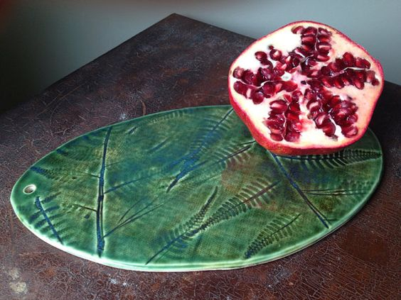 Made to order item...  -8 x 5 1/4 Hand cut oval Ceramic plate made from brown clay. I have imprinted ferns from my garden by pushing them into