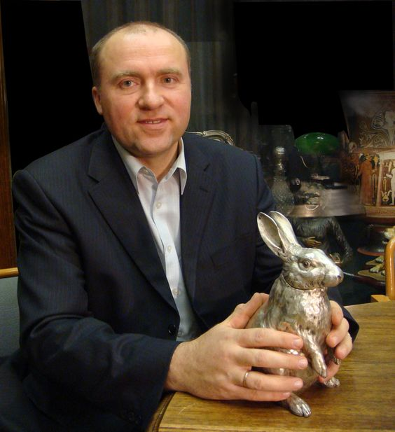 Alexander Ivanov, owner and director of the Faberge Museum at Baden-Baden, Germany, and a silver Faberge rabbit.